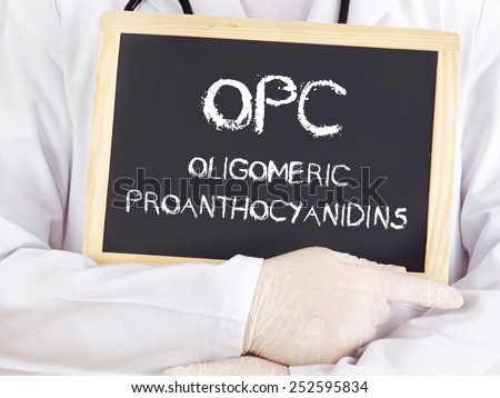 Doctor shows information: Oligomeric proanthocyanidins - stock photo