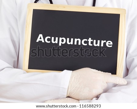 Doctor shows information on blackboard: acupuncture