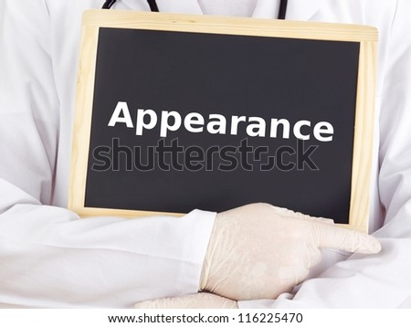 Doctor shows information on blackboard: appearance