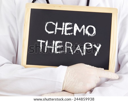 Doctor shows information on blackboard: chemotherapy - stock photo