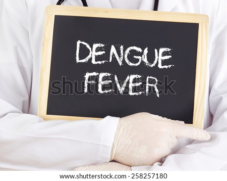 Doctor shows information on blackboard: Dengue fever - stock photo