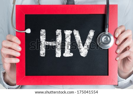 Doctor shows information on blackboard: hiv  - stock photo