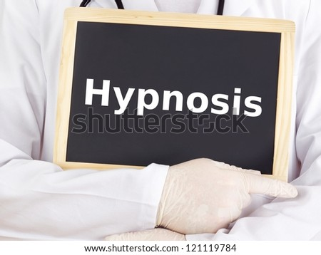 Doctor shows information on blackboard: hypnosis - stock photo