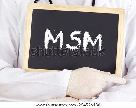 Doctor shows information on blackboard: MSM - stock photo