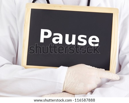 Doctor shows information on blackboard: pause