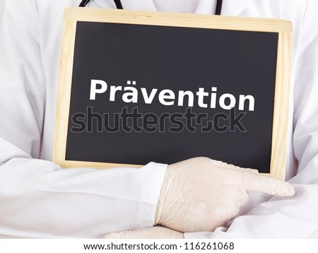 Doctor shows information on blackboard: prevention - stock photo
