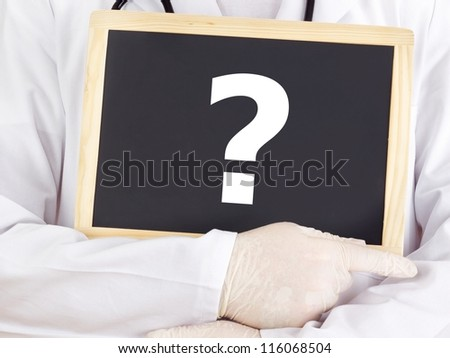 Doctor shows information on blackboard: question mark - stock photo