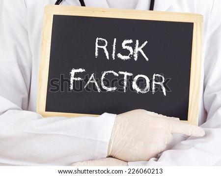 Doctor shows information on blackboard: risk factor