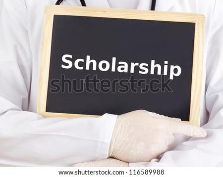 Doctor shows information on blackboard: scholarship - stock photo