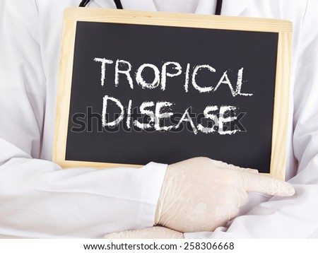 Doctor shows information on blackboard: Tropical disease - stock photo