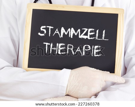 Doctor shows information: stem cell therapy in german - stock photo