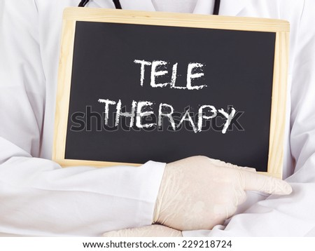 Doctor shows information: teletherapy - stock photo