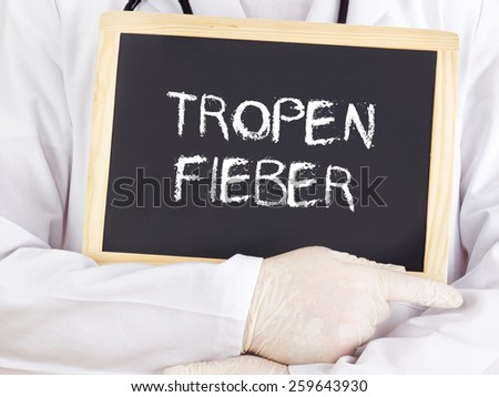 Doctor shows information: Tropical fever in german - stock photo
