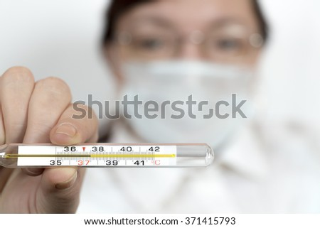 Doctor shows thermometer