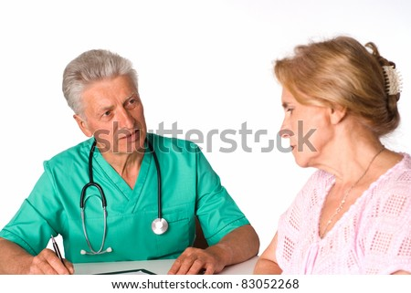 doctor sits at table with a sad patient