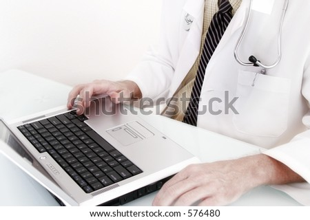 Doctor sitting at laptop computer