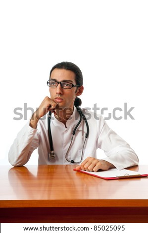 Doctor sitting at the desk on white