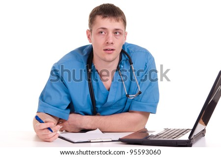 Doctor sitting at the laptop on a isolate - stock photo
