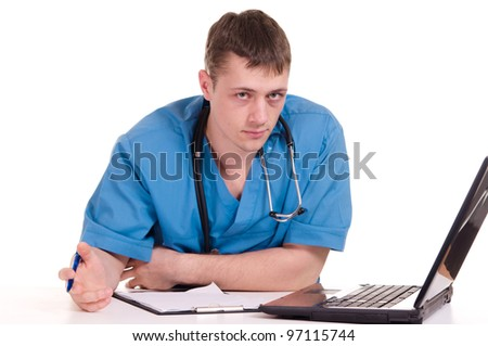 Doctor sitting at the laptop on a light