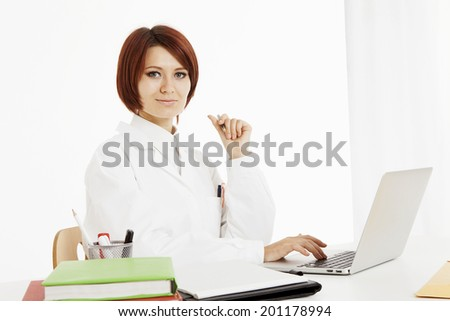 Doctor sitting behind her desk, on white background - stock photo