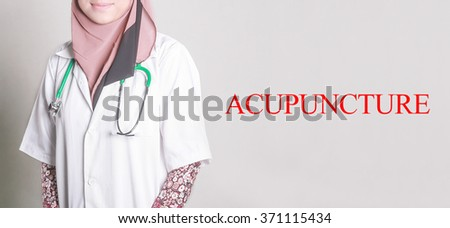 Doctor Standing front of Wall written ACUPUNCTURE - stock photo