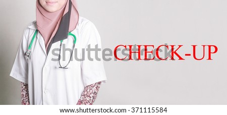 Doctor Standing front of Wall written CHECK-UP - stock photo
