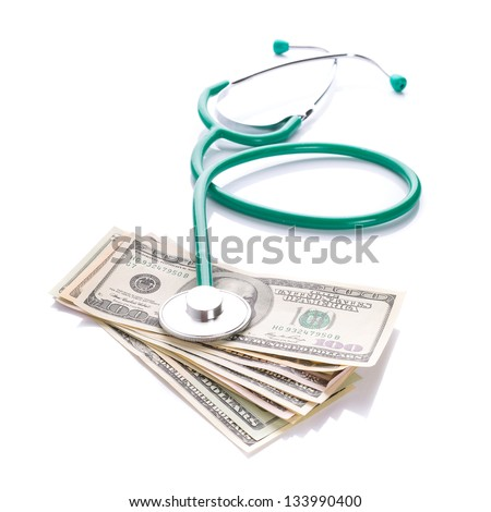 Doctor stethoscope with cash in dollars over white - stock photo