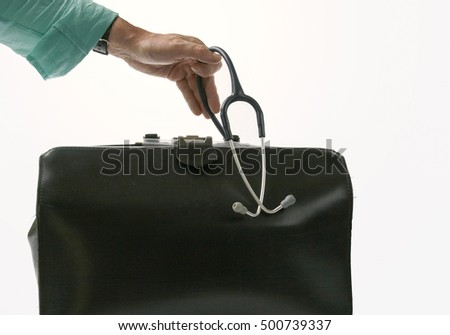 Doctor takes stethoscope out of doctor's bag. Isolated on white