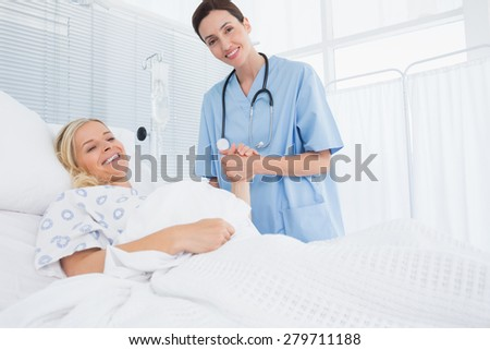 Doctor taking care of patient in hospital room - stock photo