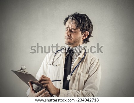 Doctor taking notes  - stock photo