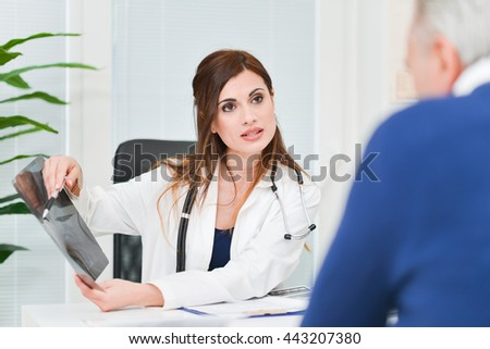 Doctor talking to a patient in her office