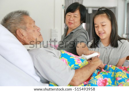 Doctor Talking To Patient In Hospital, Asian old man and family in hospital.