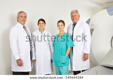 Doctor team with doctors and nurse in radiology in a hospital - stock photo