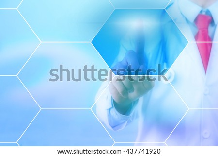 Doctor touching on virtual hexagonal screen with copyspace - stock photo