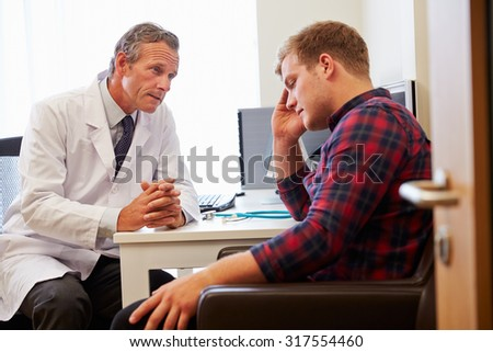 Doctor Treating Male Patient Suffering With Depression - stock photo