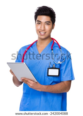 Doctor use of digital tablet - stock photo