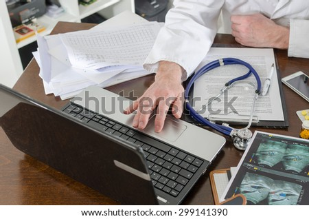 Doctor using a laptop at his desk