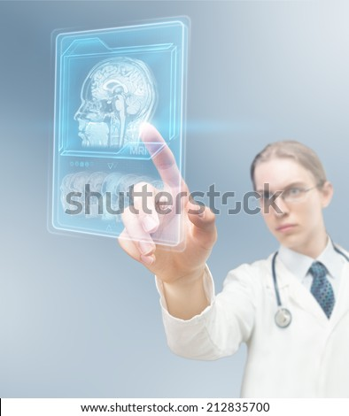 Doctor using magnetic resonance - stock photo