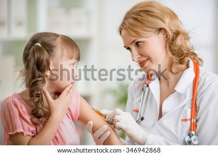doctor vaccinating frightened preschool child - stock photo