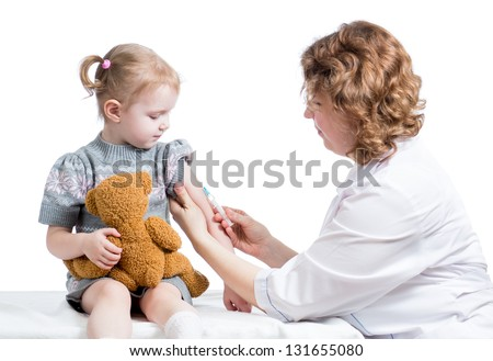 doctor vaccinating kid isolated on white - stock photo
