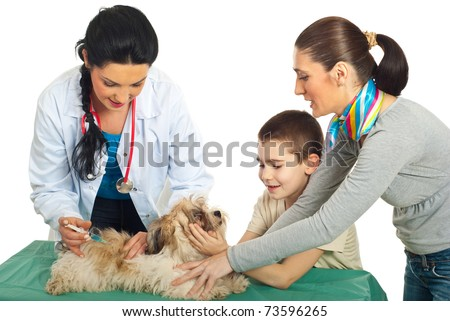 Doctor vet vaccine puppy dog and his family holding against white background - stock photo