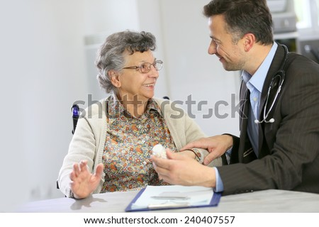 Doctor visiting elderly patient at home