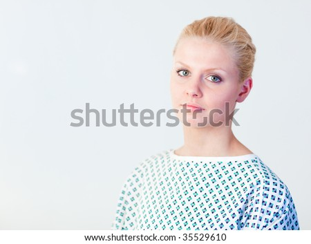 Doctor wearing a patients gown - stock photo