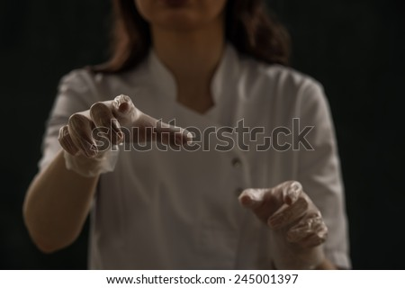 Doctor wearing gloves working with virtual screen
