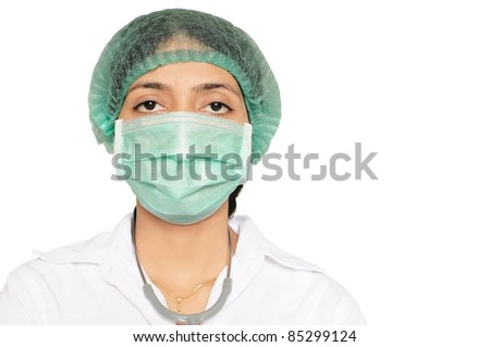 Doctor wearing mask and head cap, with stethoscope in neck.