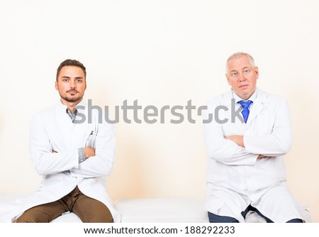 doctor white coat, folded hands, medical hospital collegues, sitting in office clinic