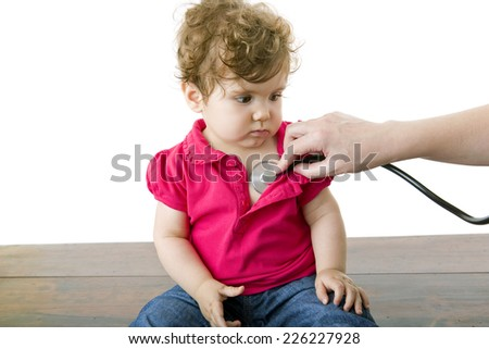 Doctor with a baby on a white background - stock photo