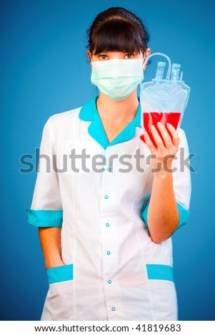 doctor with a package of donor blood - stock photo