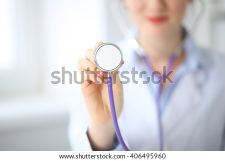 Doctor with a stethoscope in the hands - stock photo