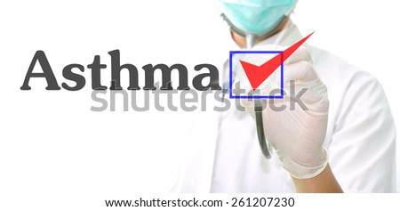 doctor with a stethoscope with the word Asthma written in it - stock photo
